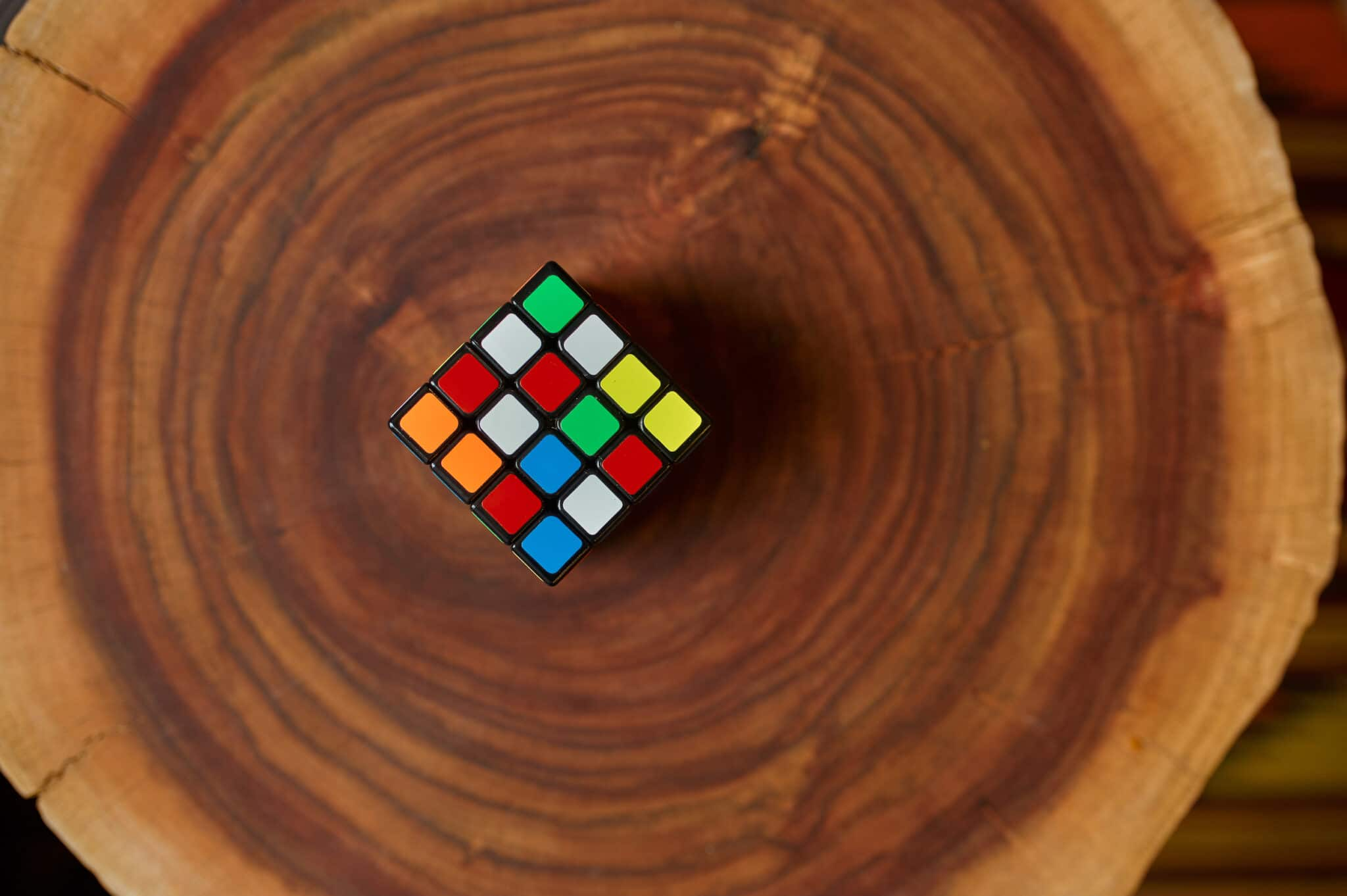 Classical colorful puzzle cube on wooden stump