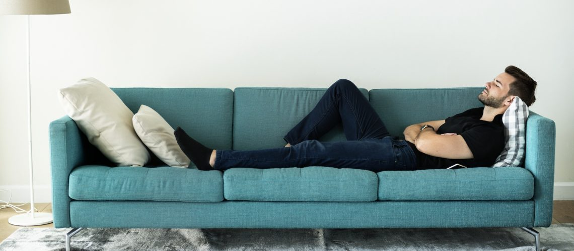man-sleeping-on-the-sofa-PUMGP73.jpg